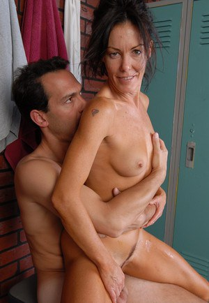 Mature brunette Nancy licking cock with tongue while giving blowjob