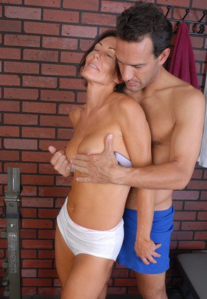 Older brunette Hope Howell has small breasts exposed before sucking cock