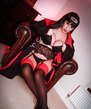Cosplay babe Yuffie Yulan exposing large tits and nipples in nylons