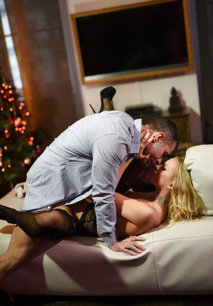 Blonde chick Kiara Lord taking cumshot on tongue after Christmas fuck