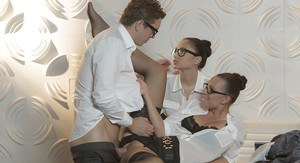 Brunette office chicks in glasses and nylons jerk off cock in threesome
