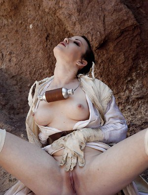 Cosplay pornstar Jennifer White spreading shaved babe pussy outdoors