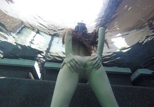 Teen chick Bella Skye spreading shaved cunt underwater outdoors Gonzo style