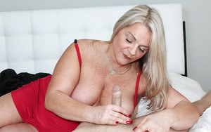 Over 40 blonde mom unleashes big boobs before giving POV handjob