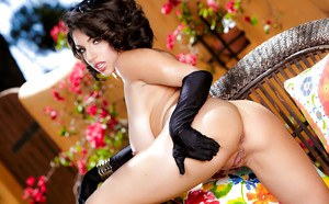 Pornstar Darcie Dolce flaunting nice melons in solo girl lingerie shoot