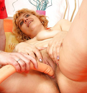 Mature lesbian lovers toy each others vagina with large sex toy