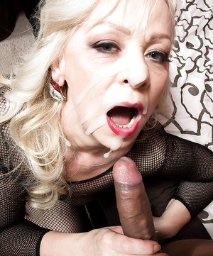 Mature blonde in crotchless fishnet bodystocking taking hardcore anal sex