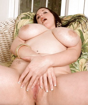 Brunette plumper Angela White flaunting huge hooters and toying pussy