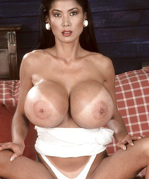 Asian MILF babe Minka fondling massive juggs in panties and high heels