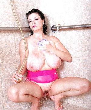 Mature Greek woman Diane Poppos getting big natural tits wet in shower