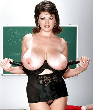 Glasses attired MILF teacher Diane Poppos toying big natural tits in class