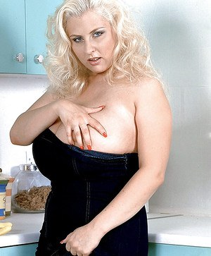 Chesty blonde mom Julia Miles flaunting monster tits in kitchen