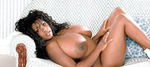 Ebony mom Sammie Black unleashing massive black tits and hairy pussy