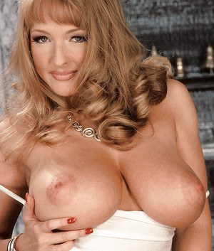 MILF Danni Ashe baring huge knockers and spreading hairy pussy