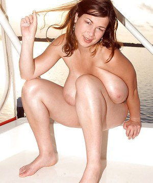 Plumper Terry Nova baring huge breasts and masturbating outdoors on boat