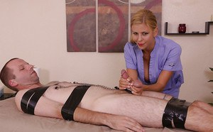 Busty blonde MILF masseuse whipping and jerking cock in femdom scene