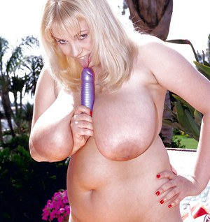 Buxom blonde fatty Inesse toying hairy twat outdoors while masturbating