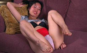 Asian amateur Ivy removing white panties to spread hairy pussy