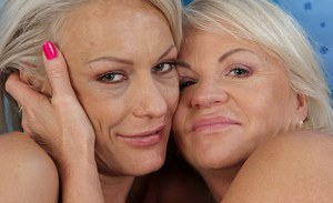 Busty mature lesbians Iris and Vanessa Moore tongue kiss before cunt eating