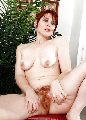 Aged redhead Lily Cade spreading hairy pierced pussy in barefeet