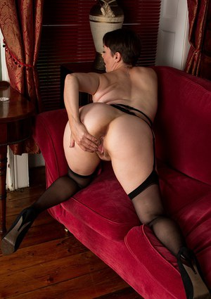 Short haired mature European woman Kitty Cream baring butt cheeks in nylons