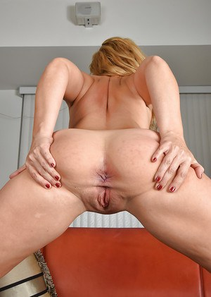 Older blonde Stevie Lix exposing shaved twat in nylons and lingerie
