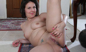 Aged brunette plumper Penny Prite baring big boobs and spreading labia lips