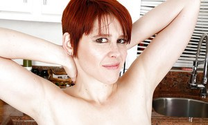 Short haired older redhead mom Lily Cade spreading hairy twat in kitchen