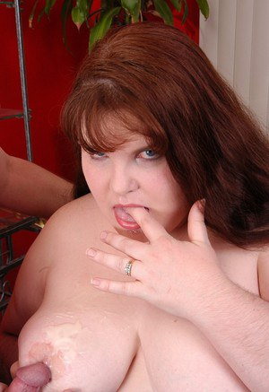 Mature redheaded fatty unveils huge saggy tits in stockings and underwear