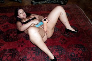 Amateur brunette SSBBW Cora Kitty toying shaved cunt while masturbating