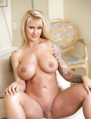Tattooed babe Ryan Conner flaunting large MILF pornstars breasts