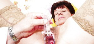 Busty older woman Zupa having hairy cunt spread by speculum up close