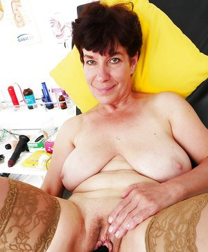 Mature woman with large breasts toying pussy during masturbation session