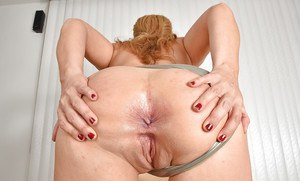 Older blonde Stevie Lix baring shaved pussy and butt cheeks up close