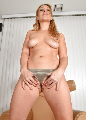 Blonde MILF babe Stevie Lix sports camel toe before spreading shaved pussy