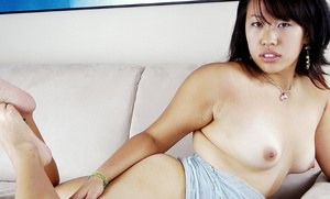 Brunette Asian first timer with small breasts spreading hairy vagina