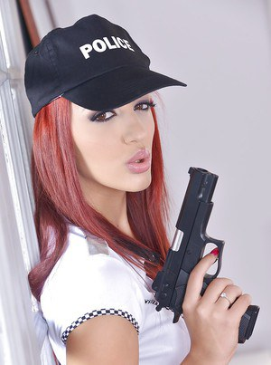 Redhead babe Aylin Diamond strips off police uniform to spread shaved cunt