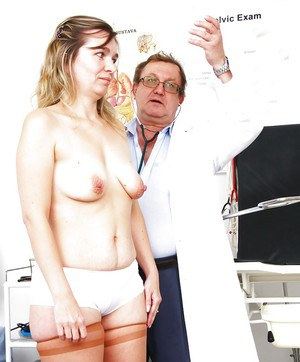 Mature lady with small saggy tits strips down to hosiery for gyno doctor