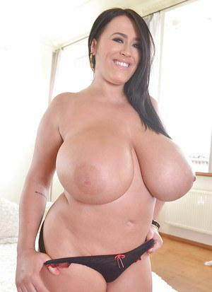 Brunette MILF plumper Leanne Crow unleashes massive juggs from lingerie
