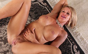 Aged blonde babe Mason Vonne flaunting big boobs while spreading pussy