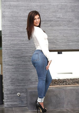 Teen babe Leah Gotti poses clothed in jeans before baring phat ass and tits