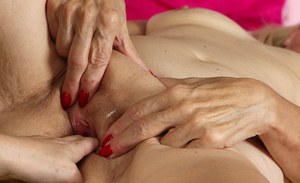 Experienced lesbians Janet Lesley and Kim Brosley lick and finger pussies