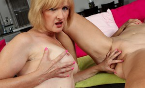 Older lesbian lovers Janet Lesley and Kim Brosley licking shaved pussies