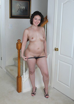 Brunette MILF Penny Prite spreading shaved pussy after ditching lingerie