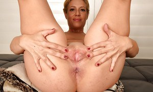 Aged Latina solo girl Stevie Lix revealing shaved vagina and anal gape
