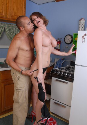 Busty mature taking hardcore interracial fucking of shaved pussy in kitchen