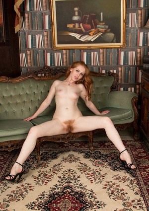 Redhead MILF babe Tia Jones flashing upskirt panties before baring beaver