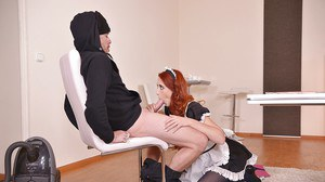 Redheaded Euro maid in uniform Isabella Lui giving blowjob on knees