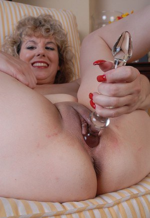 Mature blonde solo girl Crystal spreading shaved cunt for masturbation