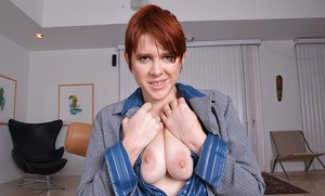 Clothed redhead babe Lily Cade undresses for spreading of hairy pussy